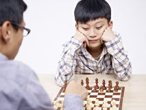 Asian father and son playing chess Royalty Free Stock Image