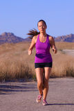 Asian Femal Runner. Beautiful asian female runner in purple top Stock Photo
