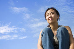 Asian Female. Against blue sky royalty free stock photo