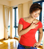 Asian female in apartment Royalty Free Stock Images