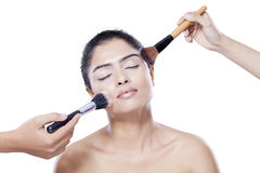 Asian female apply makeup by brush Royalty Free Stock Image