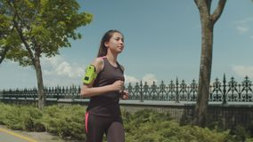 Fitness asian woman running park lane in morning stock footage