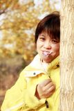 Asian female in autumn Royalty Free Stock Images