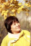 Asian female in autumn Stock Photo
