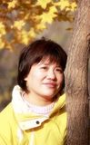 Asian female in autumn Stock Photography