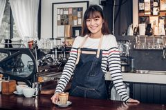 Asian female barista wear jean apron place her hand on counter b stock image