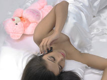 Asian female in bed Royalty Free Stock Photo