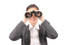 Asian female in business attire holding binoculars Stock Photos