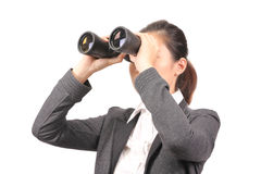 Asian female in business attire holding binoculars - Series 2 Stock Images