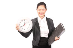 Asian female in business attire holding clock and file Stock Photos