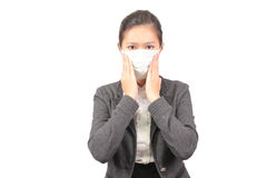 Asian female in business attire wearing a face mask Stock Photography