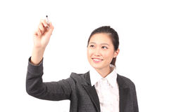 Asian female in business attire writing on marker Stock Photography