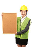 Asian female in business construction attire holding notice board Stock Photography