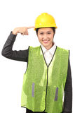 Asian female in business construction attire reminding use of safety helmet Royalty Free Stock Photos