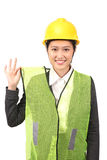 Asian female in business construction attire reminding use of safety vest Royalty Free Stock Images