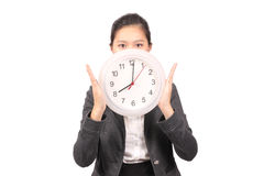 Asian female business executive holding up clock Royalty Free Stock Image