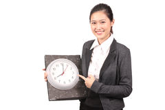 Asian female business executive pointing at clock Royalty Free Stock Photos