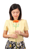 Asian female in casual wear holding flower - Series 2 Royalty Free Stock Photos