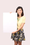 Asian female in casual wear holding  notice board - Series 2 Royalty Free Stock Photo