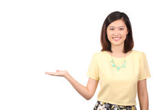 Asian female in casual wear holding out palm Royalty Free Stock Photography