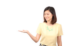 Asian female in casual wear holding out palm - Series 2 Royalty Free Stock Image