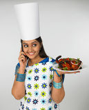 Asian female chef. With her baked chicken royalty free stock photo
