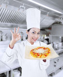 Beautiful chef and delicious pizza Royalty Free Stock Image