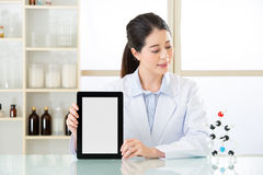 Asian female chemist showing blank notepad to research for futur. Asian female chemist use notepad to research for future Chemical formula and holding molecular Stock Images