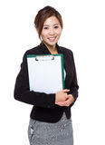Asian female with clipboard Royalty Free Stock Photos