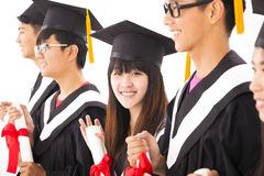 Asian female college graduate at graduation with class Royalty Free Stock Photos