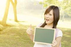 Asian female college student with blank chalkboard Stock Images