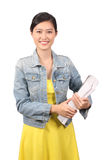 Asian female college student holding textbooks Royalty Free Stock Photo