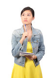 Asian female college student thinking Royalty Free Stock Photos