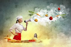 Asian female cook holding megaphone Royalty Free Stock Photo