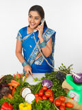 Asian female cutting vegetables Stock Images