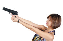 Asian Female Detective. A beautiful Asian female police detective woman on the job with a gun royalty free stock image