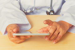 Asian female doctor diagnoses by using tablet. Royalty Free Stock Images