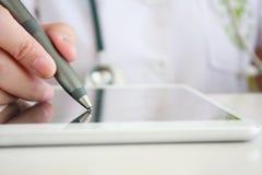 Asian female doctor hand writing digital prescription Stock Photos