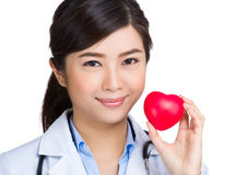 Asian female doctor hold with heart ball royalty free stock photo