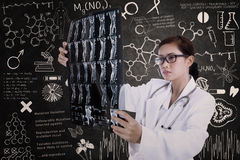 Asian female doctor hold x-ray in lab Stock Photography