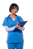 Asian female doctor holding clipboard and writing in it isolated Royalty Free Stock Photos
