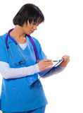 Asian female doctor holding clipboard writing writing and lookin Royalty Free Stock Photo