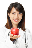 Asian female doctor holding red apple Stock Images