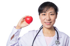Asian female doctor holding red heart with stethoscope Stock Photo