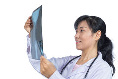 Asian female doctor looking at x-ray image Royalty Free Stock Photos