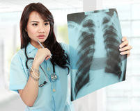 Asian female doctor looking at the x-ray Stock Photography