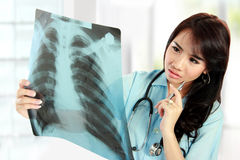 Asian female doctor looking at the x-ray Stock Photos
