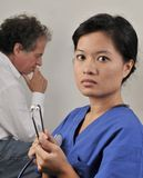 Asian Female Doctor and Patient Stock Photography