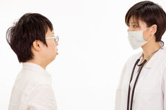 Asian female doctor with patient Royalty Free Stock Photos