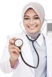 Asian female doctor smiling while using stethoscope Stock Photo